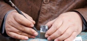 snida handstenen Arkivfoton