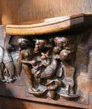Sniden medeltida kyrklig misericorde av Adam och helgdagsaftonen Arkivbild