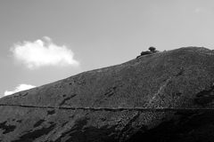 Sniezka peak with mountain refuge Royalty Free Stock Photo