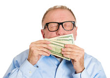 Sniffing money Stock Photo