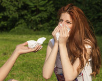 Sniffing and sneezing Stock Image