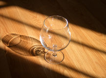 Snifter. A snifter on a wooden floor Royalty Free Stock Photo