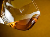 Snifter of brandy in elegant glass with space for text Royalty Free Stock Photos