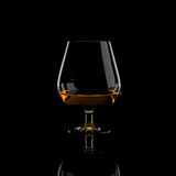 Snifter glass of cognac Royalty Free Stock Images