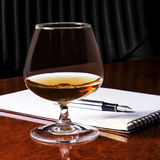 Snifter glass of cognac Stock Photo