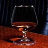 Snifter glass of cognac Stock Photo