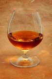Snifter glass of cognac Stock Image