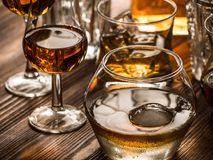 Varous glasses of whiskey on a table stock photo