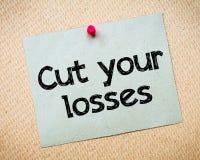 Snijd uw verliezen stock afbeeldingen