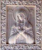 Snijdende Maagdelijke Mary stock foto's