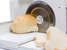 Snijmachine en brood stock afbeeldingen