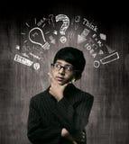 SnilleLittle Boy bärande exponeringsglas, tänkande process Arkivfoton
