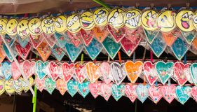 Gingerbread Heart and Smiley Face Souvenir on Display in Stall for Sale royalty free stock images