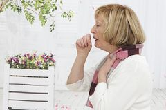 Snior woman having a flu. Sick Senior Woman coughing with a flu Stock Photography