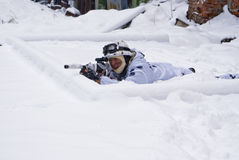 Sniper. In a winter camouflage shoots from a rifle Stock Photos
