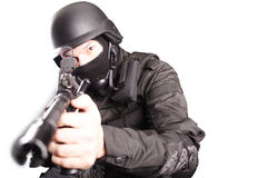 Sniper. Shot of a soldier holding gun. Uniform conforms to special services(soldiers) of the NATO countries. Shot in studio. Isolated with clipping path Stock Image