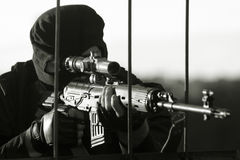 Sniper. In a camouflage shoots from a rifle Stock Photos