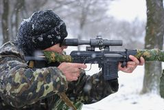 The sniper. The soldier. The sniper. A sniper rifle. Winter forest. Snow Stock Photos