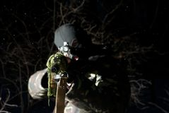 Sniper. The military man. The armed. Winter forest. Night. Snow Royalty Free Stock Images