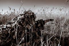 Sniper. In ambush with rifle_ sepia Stock Image