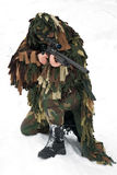 Sniper. A man in a camouflage fires a sniper rifle Stock Photo