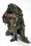 Sniper. A man in a camouflage fires a sniper rifle Stock Images