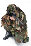 Sniper. A man in a camouflage fires a sniper rifle Royalty Free Stock Photography
