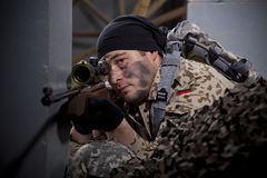 Sniper aiming. Military scene making in a studio stock photos