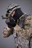 Sniper aiming. Military scene shot in a studio over grey background royalty free stock photography