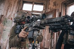 Sniper aiming from rifle. Selective focus royalty free stock image