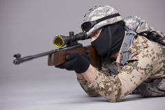 Sniper aiming in studio Stock Photos