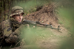 Sniper with automatic weapon. Sniper in military uniform with automatic weapon Royalty Free Stock Image