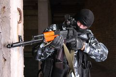 Sniper in black mask targeting stock images