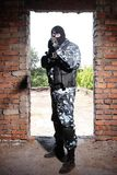 Sniper in black mask targeting with a gun Royalty Free Stock Photography