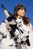 Sniper girl in white camouflage. Aiming with rifle on a blue sky background Royalty Free Stock Photo