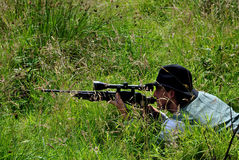 Sniper in the grass Stock Images