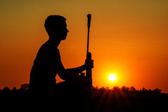 The sniper has a rest. Rest of the sniper with a rifle against the coming sun Stock Photo