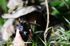 Sniper hiding in bushes royalty free stock images