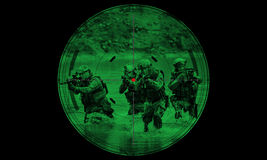 Sniper during night operation hostage rescue.view through the ni Stock Images