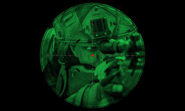 Sniper during night operation hostage rescue.view through the ni Royalty Free Stock Photos