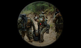 Sniper during night operation hostage rescue.view through the ni Royalty Free Stock Images