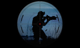 Sniper during night operation hostage rescue.view through the ni Stock Photo