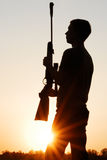 The sniper with a rifle. Against a decline Royalty Free Stock Photography