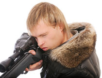 Sniper with rifle aims Stock Image