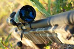 Sniper rifle. Bolt action sniper rifle with telescopic sight closeup , shallow dof Royalty Free Stock Images