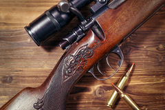 Sniper rifle with bullets Stock Photography