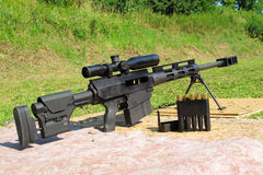Sniper rifle caliber .50 BMG with ammo. On shooting range Royalty Free Stock Image