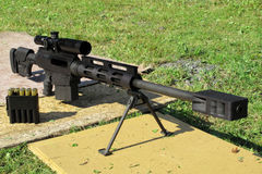 Sniper rifle caliber .50 BMG in front. Sniper rifle caliber .50 BMG with muzzle brake Royalty Free Stock Images