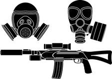 Sniper rifle and gas masks Royalty Free Stock Photos