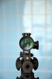 Sniper rifle with rifle scope. Designed marksman rifle with attached rifle scope. Focus is on the scope Stock Images